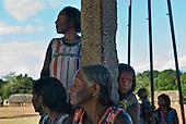 Pará State, Brazil. Aldeia Kikretum. Djope Kayapó, women watch arrival of the health visitor.