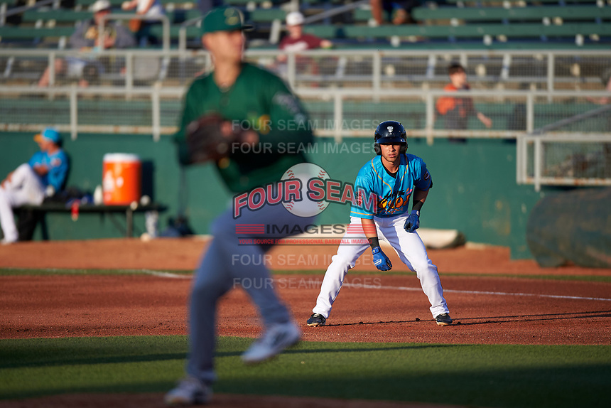 Lansing Lugnuts Dominic Abbadessa (1) takes a lead off first base during a Midwest League game against the Beloit Snappers at Cooley Law School Stadium on May 4, 2019 in Lansing, Michigan. The Lugnuts wore their Copa de la Diversión jerseys, becoming the Lansing Locos for the evening. Beloit defeated Lansing 2-1. (Zachary Lucy/Four Seam Images)
