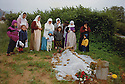 France 1992 The burial of Fatiha in the graveyard of Mainsat. Mohammed rashid , her son with his family around the          grave  France 1992 L'enterrement de Fatiha, kurde refugiée a Mainsat dans la Creuse.Autour de la tombe, Mohammed Rashid, son fils et sa famille.