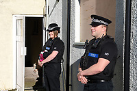 Pictured: Police officers in Monkton, Pembrokeshire, Wales, UK. Wednesday 12 July 2017<br /> Re: A riot broke out in a quiet country village when more than 200 protesters threw stones and lit fires outside the house of a woman they suspected of being a sex offender.<br /> The angry mob shouting 'paedo' and 'nonce' were broken up by at about 4am when the 24-year-old woman and another person were escorted from the house by armed police.<br /> The crowd had gathered in Monkton, Pembrokeshire just after 9pm on Tuesday night after a series of sex allegations against the woman were made on Facebook.