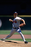 SAN FRANCISCO, CA:  Greg Maddux of the Atlanta Braves pitches during a game against the San Francisco Giants at Candlestick Park in San Francisco, California in 1995. (Photo by Brad Mangin)