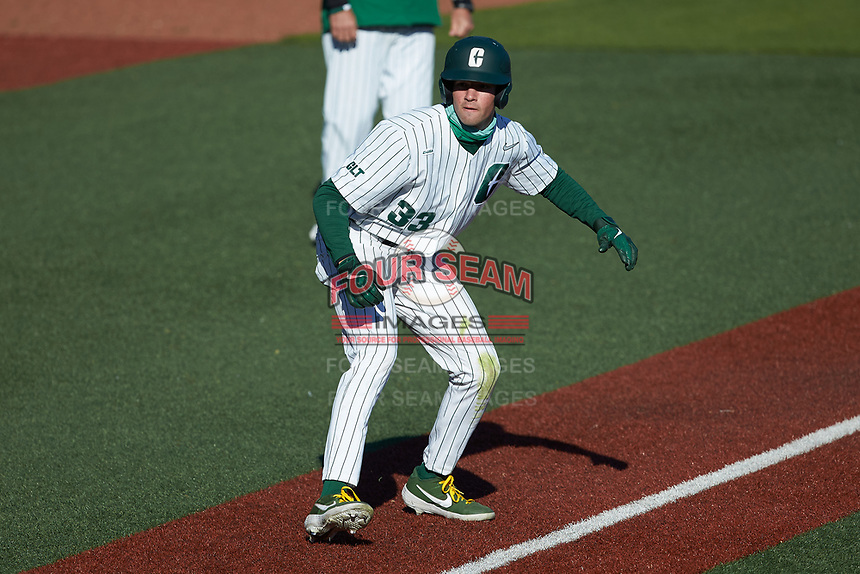 Jake Cunningham (33) of the Charlotte 49ers takes his lead off of third base against the Florida Atlantic Owls at Hayes Stadium on April 2, 2021 in Charlotte, North Carolina. The 49ers defeated the Owls 9-5. (Brian Westerholt/Four Seam Images)