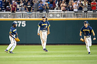 Michigan Wolverines outfielders Christian Bullock (5), Jordan Brewer (22) and Jesse Franklin (7) celebrate following Game 6 of the NCAA College World Series against the Florida State Seminoles on June 17, 2019 at TD Ameritrade Park in Omaha, Nebraska. Michigan defeated Florida State 2-0. (Andrew Woolley/Four Seam Images)