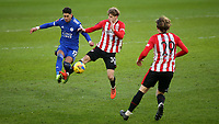 Ayoze Perez of Leicester City and Brentford's Mads Roerslev challenge for the ball during Brentford vs Leicester City, Emirates FA Cup Football at the Brentford Community Stadium on 24th January 2021