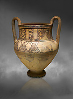 Phrygian terra cotta amphora decorated with geometric designs from Gordion. Phrygian Collection, 8th century BC - Museum of Anatolian Civilisations Ankara. Turkey. Against a grey background