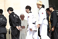 Alcuni giovani atleti di Taekwondo provenienti dalla Corea del Sud salutano Papa Francesco durante l'udienza generale del mercoledi' in Piazza San Pietro, Citta' del Vaticano, 30 maggio, 2018.<br /> Taekwondo athletes from South Korea greets Pope Francis during his weekly general audience in St. Peter's Square, at the Vatican, on May 30, 2018.<br /> UPDATE IMAGES PRESS/IsabellaBonotto<br /> <br /> STRICTLY ONLY FOR EDITORIAL USE