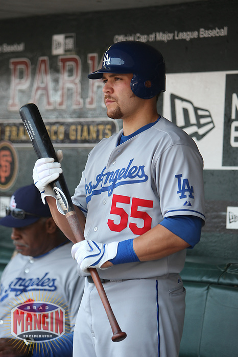 SAN FRANCISCO - JULY 6:  Russell Martin of the Los Angeles Dodgers gets ready in the dugout before the game against the San Francisco Giants at AT&T Park in San Francisco, California on July 6, 2008.  The Dodgers defeated the Giants 5-3.  Photo by Brad Mangin