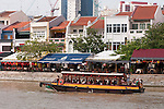Tourist 'bumboat' on the Singapore river at the Boat Quay restaurant area, Singapore