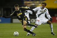 Columbus Crew's Kyle Martino (10) and Los Angeles Galaxy's Guillermo Ramirez (right) during the second half at Columbus Crew Stadium in Columbus, Ohio Saturday April 2, 2005.
