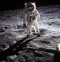 "20 July 1969  File Photo - Astronaut Edwin E. Aldrin Jr., lunar module pilot, walks on the surface of the moon near the leg of the Lunar Module (LM) ""Eagle"" during the Apollo 11 extravehicular activity (EVA)."