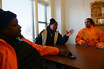 """Cease Fire outreach workers and violence interrupters (l-r) James Sima, 39, supervisor Ulysses """"US"""" Floyd, and Jerusha """"Rue"""" Hodge, 42, briefing in their office on recent developments in the neighborhoods where they work with at risk youth participants on the far South Side of Chicago, Illinois on February 3, 2017.  Cease Fire is a public health initiative that attempts to stop or halt gun violence across the city."""