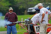 (LtoR): Eddie Giraud, Andy Tate  (hidden) and Mark Tate warm up their engine.