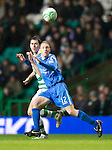 Celtic v St Johnstone....26.12.10  .Steven Anderson holds off Daryl Murphy.Picture by Graeme Hart..Copyright Perthshire Picture Agency.Tel: 01738 623350  Mobile: 07990 594431