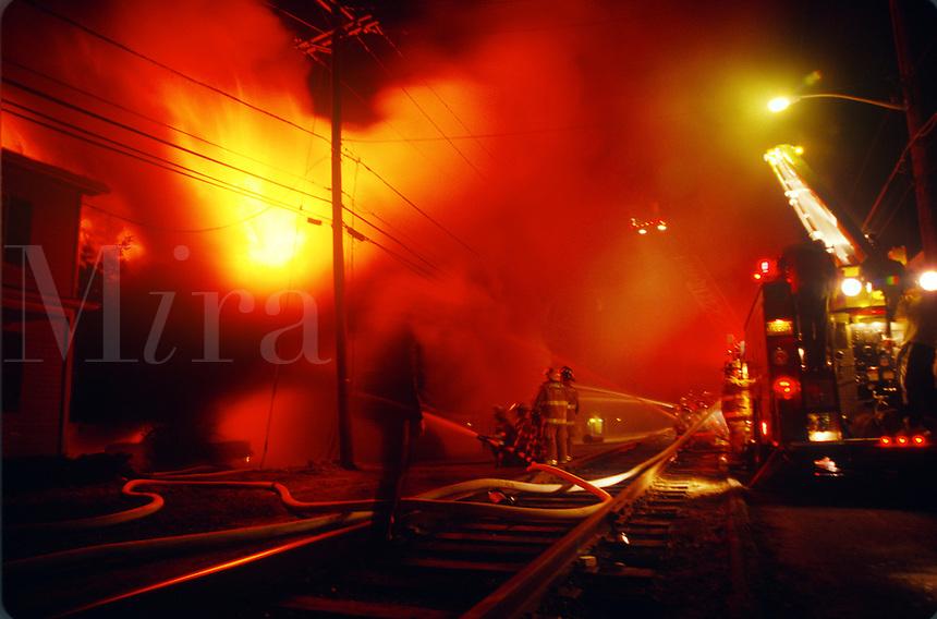 Firefighters battle a house fire.<br />
