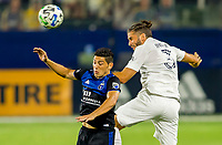 CARSON, CA - OCTOBER 14: Cristian Espinoza #10 of the San Jose Earthquakes and Cristian Espinoza 10 Emiliano Insua #3 of the Los Angeles Galaxy battle for a ball in the air during a game between San Jose Earthquakes and Los Angeles Galaxy at Dignity Heath Sports Park on October 14, 2020 in Carson, California.
