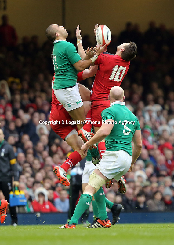 Pictured L-R: Simon Zebo of Ireland battles against Dan Biggar of Wales to catch the ball  Saturday 14 March 2015<br /> Re: RBS Six Nations, Wales v Ireland at the Millennium Stadium, Cardiff, south Wales, UK.