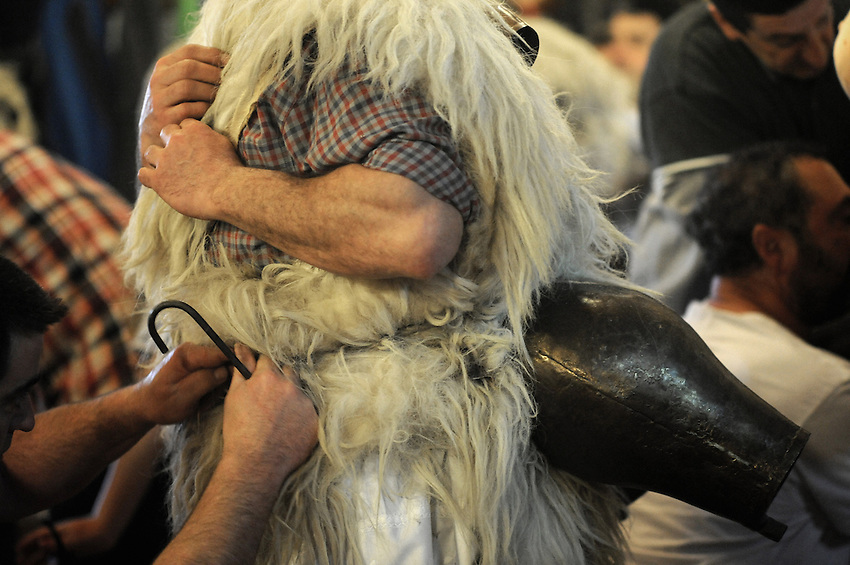"""A """"Joaldun"""" group get ready on January 27, 2014 at the village of Ituren, Basque Country. Joaldun groups perform an ancient traditional carnival at the villages of Ituren and Zubieta during two days, carrying sheep furs and big cowbells in their backs and making sound them in order to wake up the earth, to ask for a good new year, a good harvest and also to keep away the bad spirits. (Ander Gillenea / Bostok Photo)"""