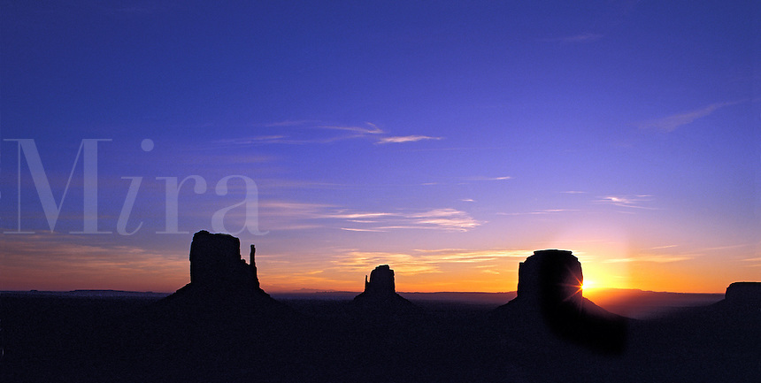 Dawn coming up behind the Mitten Buttes and Merrick Butte, Monument Valley, Utah/Arizona border, US