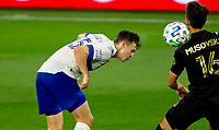 LOS ANGELES, CA - SEPTEMBER 02: Tanner Beason #15 of the San Jose Earthquakes heads a ball during a game between San Jose Earthquakes and Los Angeles FC at Banc of California stadium on September 02, 2020 in Los Angeles, California.