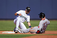 Peoria Javelinas Drew Jackson (18), of the Seattle Mariners organization, tags Danny Mars (22) sliding into second base during a game against the Surprise Saguaros on October 12, 2016 at Peoria Stadium in Peoria, Arizona.  The game ended in a 7-7 tie after eleven innings.  (Mike Janes/Four Seam Images)