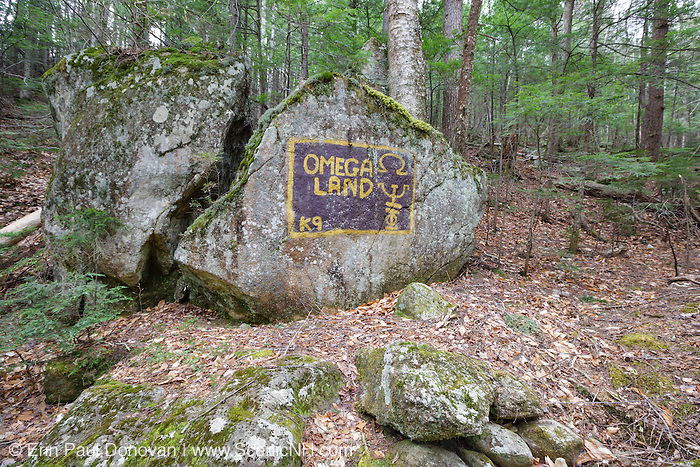 Graffiti painted on boulder along the Mount Tremont Trail in the White Mountains, New Hampshire USA during the spring months.