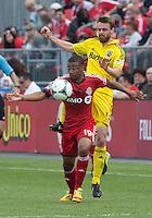 18 May 2013: Toronto FC midfielder Reggie Lambe #19 and Columbus Crew midfielder/forward Eddie Gaven #12 in action during an MLS game between the Columbus Crew and Toronto FC at BMO Field in Toronto, Ontario Canada..The Columbus Crew won 1-0...