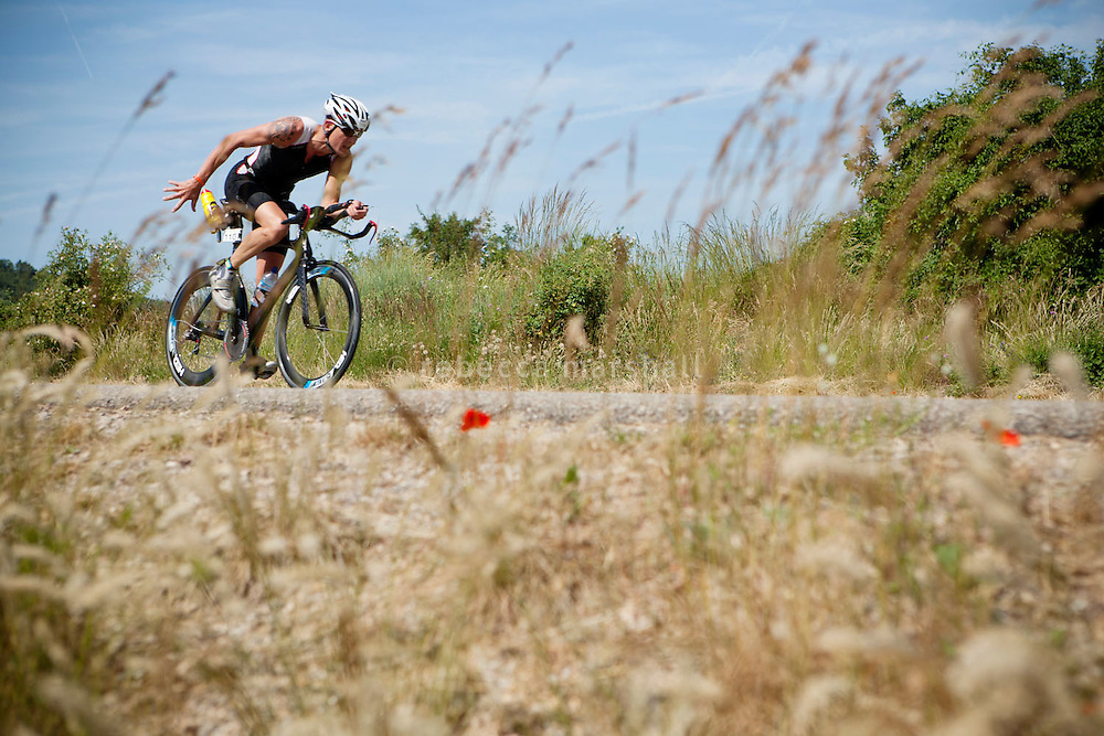 A triathlete on the bike course of Ironman France 2012, Nice, France, 24 June 2012
