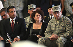 From left, Nevada Gov. Brian Sandoval, First Lady Kathleen Sandoval and Brig. Gen. William R. Burks attend a memorial ceremony for three Nevada National Guard members killed earlier this week by a gunman in an IHOP restaurant. An estimated 700 people attended the ceremony in Carson City, Nev., Sunday afternoon, Sept. 11, 2011. (AP Photo/Cathleen Allison)