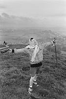 A man sings in the morning after the Summer solstice after a night on Tor Hill, Glastonbury, Somerset.