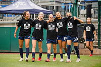 TACOMA, WA - JULY 31: OL Reign enters the pitch for warmups before a game between Racing Louisville FC and OL Reign at Cheney Stadium on July 31, 2021 in Tacoma, Washington.