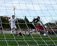 Carolina keeper Jimmy Maurer goes wide for a save as Mike Mangotic (4) looks on