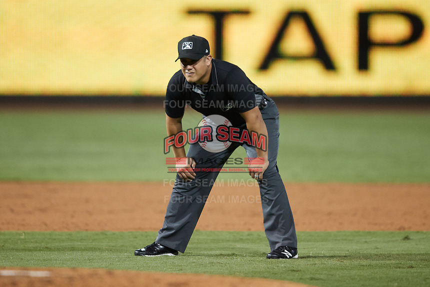 Umpire Rainiero Valero handles the calls on the bases during the game between the Bowling Green Hot Rods and the Winston-Salem Dash at Truist Stadium on September 9, 2021 in Winston-Salem, North Carolina. (Brian Westerholt/Four Seam Images)