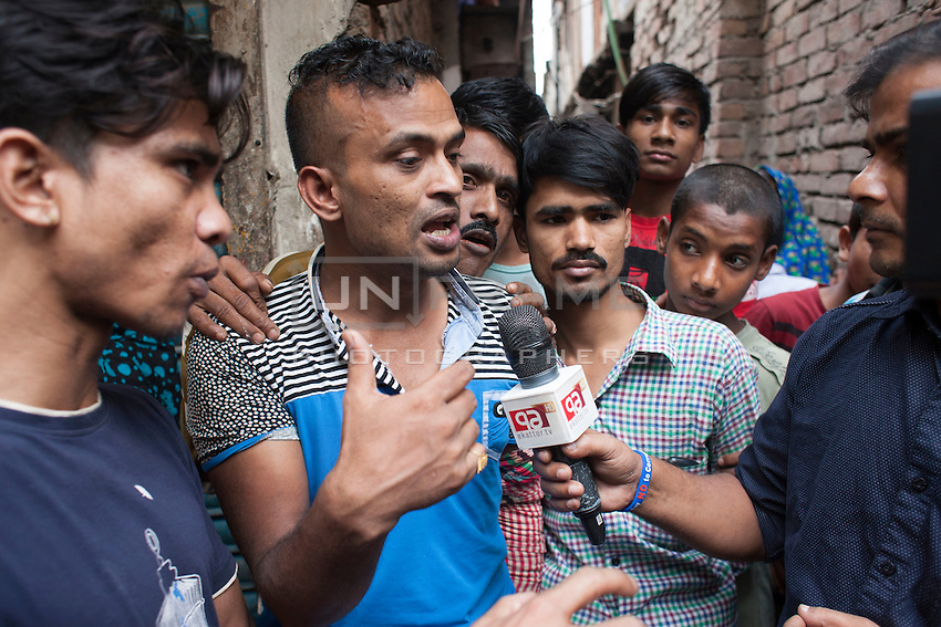 A witness describes to a media how they caught two suspected murderer with the help of local police. Bangladeshi blogger Oyasiqur Rahman Babu hacked to death today around 9:45am at the Tejgaon Indsutrial area in Dhaka, Bangladesh, March 30, 2015. Two madrasa students have been detained with sharp weapons for suspected involvement with the murder. Three meat cleavers have been recovered from the spot. This assassination follows a similar murder of blogger-writer Avijit Roy on Feb 25 at the Dhaka University campus. The two arrested for suspected involvement are  'Zikrullah', a Chittagong madrassa student ,  and Arif', a student of  a madrasa in Dhaka's Mirpur area, according to police.