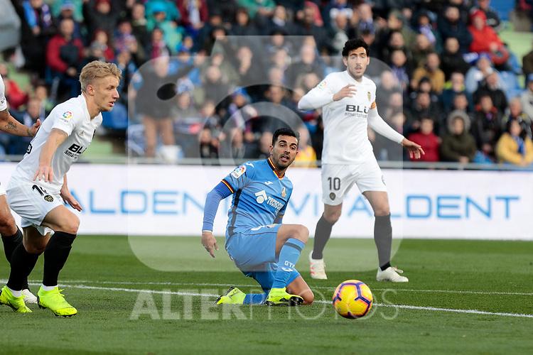 Getafe CF's Jorge Molina and Valencia CF's Daniel Wass during La Liga match between Getafe CF and Valencia CF at Coliseum Alfonso Perez in Getafe, Spain. November 10, 2018.
