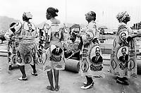 Cameroon. Yaounde. Congress hall. Aids week (nov 26 to dec 1 2001). Celebrations for Aids day which is is on the first of december. Women wearing loincloth showing the face of Mr. Paul Biya, president of Cameroon. They dance and sing for the celebrations of Aids day. © 2001 Didier Ruef