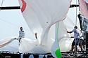 Louis Vuitton Trophy La Maddalena 1 giugno 2010. Ammainata dello spinnaker a bordo di BMW Oracle al termine di una regata che li ha opposti ad Azzurra. La vittoria è andata agli statunitensi.