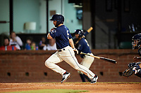 Mobile BayBears left fielder Forrestt Allday (5) follows through on a swing during a game against the Pensacola Blue Wahoos on April 25, 2017 at Hank Aaron Stadium in Mobile, Alabama.  Mobile defeated Pensacola 3-0.  (Mike Janes/Four Seam Images)
