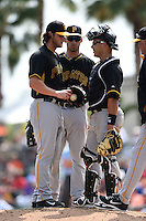 Pitcher Gerrit Cole, first baseman Travis Ishikawa and catcher Tony Sanchez of the Pittsburgh Pirates during a spring training game against the Baltimore Orioles on March 23, 2014 at McKechnie Field in Bradenton, Florida.  Baltimore and Pittsburgh played to a 7-7 tie.  (Mike Janes/Four Seam Images)