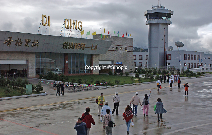 Tourists arrive in the recently completed airport at Da Qing, Yunnan Province.  Da Qing county is a Tibetan area and part of the Tibetan Plateau and has been designated by the Chinese authorities as Shangrila. It is being developed as a tourist mecca with a new airport and hotels catering for thousands of tourists.