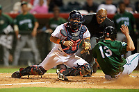 Florida Fire Frogs catcher Jonathan Morales (4) can not come up with the throw as Nick Senzel (13) slides home safely with umpire Jose Navas looking on to make the call during the teams inaugural game against the Daytona Tortugas on April 6, 2017 at Osceola County Stadium in Kissimmee, Florida.  Daytona defeated Florida 3-1.  (Mike Janes/Four Seam Images)