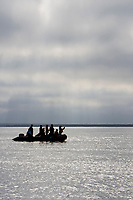 grayhale watchers looking for California Gray grayhales (Eschrichtius robustus) in the fog in Magdalena Bay near Puerto Lopez Mateos on the Pacific Ocean side of the Baja Peninsula, Baja California Sur, Mexico. Each winter thousands of California gray whales migrate from the Bering and Chukchi seas to breed and calf in the warm water lagoons of Baja. This is the furthest sout of the three major such lagoons. Current (2008) population estimates put the California Gray grayhale at between 20,000 and 24,000 animals.