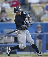 Junior Spivey of the Arizona Diamondbacks bats during a 2002 MLB season game against the Los Angeles Dodgers at Dodger Stadium, in Los Angeles, California. (Larry Goren/Four Seam Images)