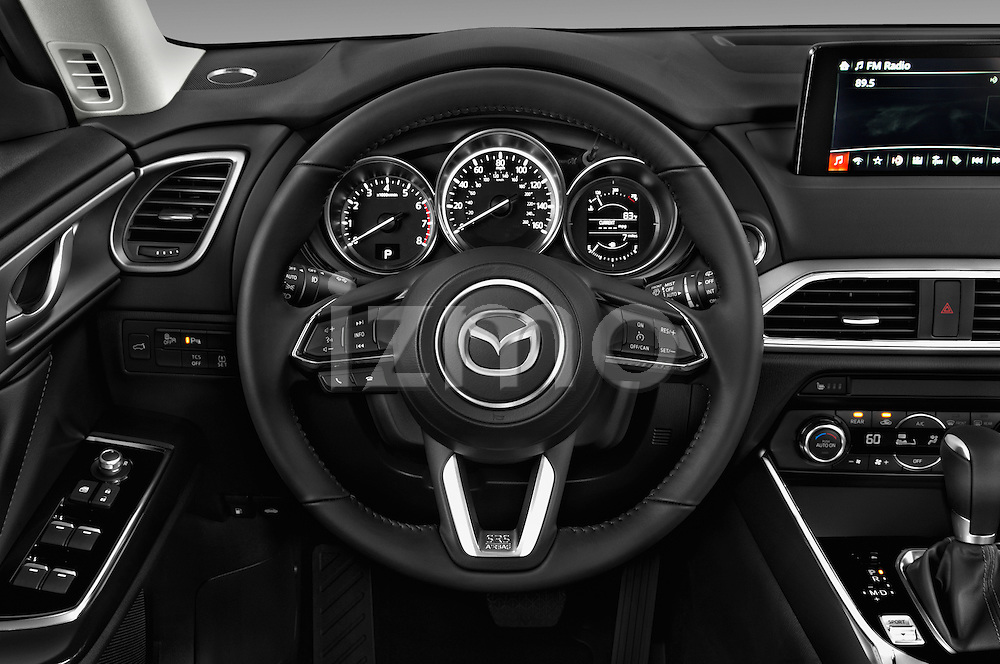 Car pictures of steering wheel view of a 2018 Mazda CX-9 Touring-FWD 5 Door SUV Steering Wheel