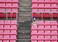KASHIMA, JAPAN - AUGUST 2: A volunteer sits in the stands during a game between Canada and USWNT at Kashima Soccer Stadium on August 2, 2021 in Kashima, Japan.