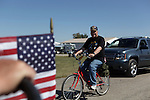 A Veteran passes on a bicycle. Vietnam Veterans gather in Kokomo, Indiana for the 2009 reunion.