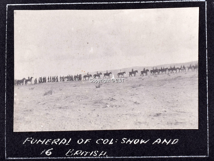 BNPS.co.uk (01202 558833)<br /> Pic: C&T/BNPS<br /> <br /> Funeral of Colonel Snow and 16 other casualties - The little known Senussi campaign of January 1916.<br /> <br /> Never before seen photos of the disastrous Gallipoli campaign have come to light over a century later.<br /> <br /> The fascinating snaps were taken by Sub Lieutenant Gilbert Speight who served in the Royal Naval Air Service in World War One.<br /> <br /> They feature in his photo album which covers his eventful war, including a later stint in Egypt.<br /> <br /> There are dramatic photos of the Allies landing at X Beach, as well as sobering images of a mass funeral following the death of 17 Brits. Another harrowing image shows bodies lined up in a mass grave.<br /> <br /> The album, which also shows troops during rare moments of relaxation away from the heat of battle, has emerged for sale with C & T Auctions, of Ashford, Kent. It is expected to fetch £1,500.