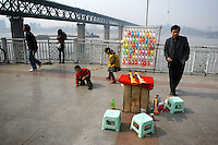 CHINA. Hubei Province. Wuhan. A games stall near to the Yangtze River. Wuhan (population 4.3 million) is a sprawling city that sits on both sides of the Yangtze River. Its trade has been inextricably linked with the Yangtze river for centuries. The Yangtze River is reported to be at its lowest level in 150 years as a result of a country-wide drought. It is China's longest river and the third longest in the world. Originating in Tibet, the river flows for 3,964 miles (6,380km) through central China into the East China Sea at Shanghai.  2008.