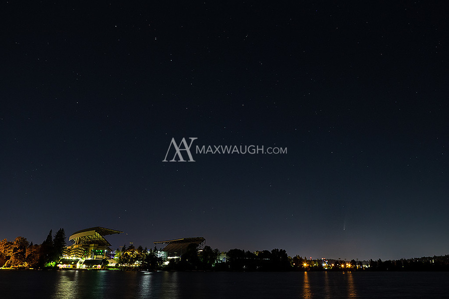 Comet NEOWISE and the Big Dipper hover in the sky near Husky Stadium in Seattle.