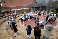 Attendees cheer Tuesday April 6, 2021 during a rally for non-profits held in Fayetteville at the Walton Arts Center's rose garden. The rally was for nonprofits and event organizers come together to create excitement for the fourth annual NWA Gives event which is on Thursday, April 8.  Local charities signed up for the event will encourage their supporters to participate in 12 hours of giving on Thursday. Visit nwaonline.com/210407Daily/ and nwadg.com/photos. (NWA Democrat-Gazette/J.T. Wampler)