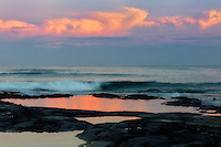 Tidepool reflection with sunrise. The Kohala Coast. The Big Island, Hawaii.